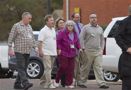 """The family of slain Houston Police officer Guy Gaddis enters the """"Walls"""" prison unit to witness the execution of Edgar Tamayo in Huntsville, Texas January 22, 2014. REUTERS/Richard Carson"""