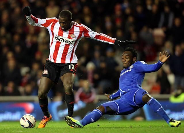 Sunderland's Jozy Altidore, left, vies for the ball with Chelsea's Michael Essien, right, during their English League Cup quarter final soccer match at the Stadium of Light, Sunderland, England, Tuesday, Dec. 17, 2013. (AP Photo/Scott Heppell)