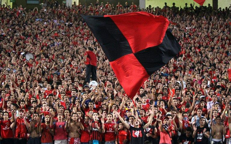 Egyptian fans of Al Ahly club cheer before a match in Cairo on August 29, 2010