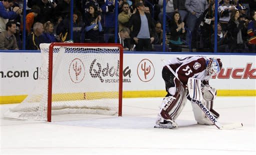 Colorado Avalanche goalie Jean-Sebastien Giguere stands in goal after giving up a goal to St. Louis Blues' David Backes during the second period of an NHL hockey game Saturday, Jan. 7, 2012, in St. Louis. (AP Photo/Jeff Roberson)