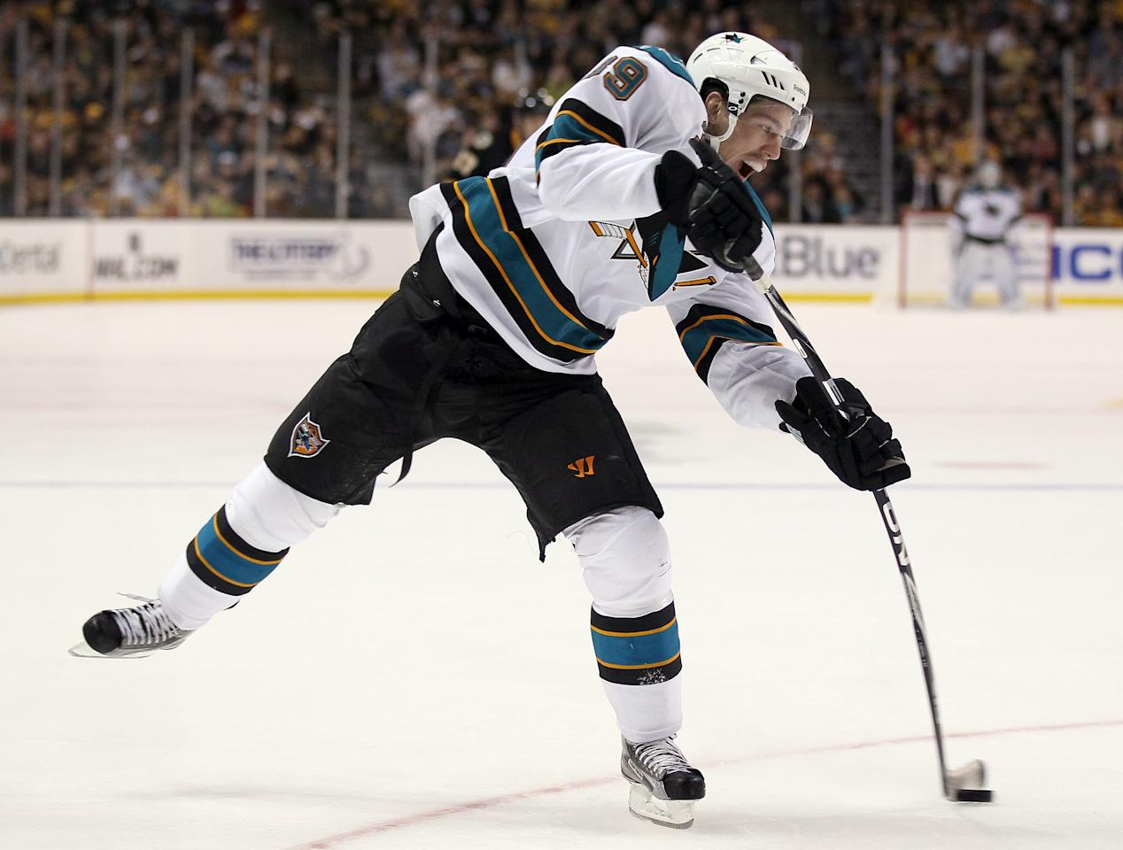 BOSTON, MA - OCTOBER 22:  Logan Couture #39 of the San Jose Sharks takes a shot in the second period against the Boston Bruins on October 22, 2011 at TD Garden in Boston, Massachusetts.  (Photo by Elsa/Getty Images)