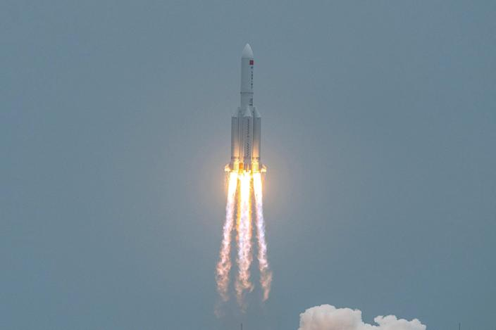<p>A Long March 5B rocket, carrying China's Tianhe space station core module, lifts off from the Wenchang Space Launch Center in southern China's Hainan province on April 29, 2021</p> (Photo by STR/AFP via Getty Images)