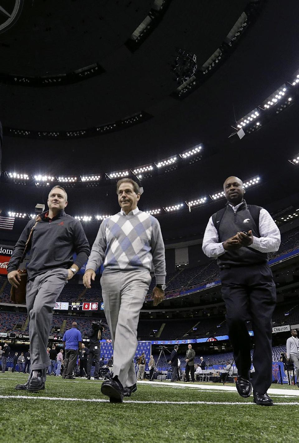 Alabama head coach Nick Saban walks on the field at the conclusion of media day at the Mercedes-Benz Superdome in New Orleans, Tuesday, Dec. 30, 2014. They are scheduled to face Ohio State in the Allstate Sugar Bowl NCAA football game, which will be played on New Year's Day. (AP Photo/Gerald Herbert)