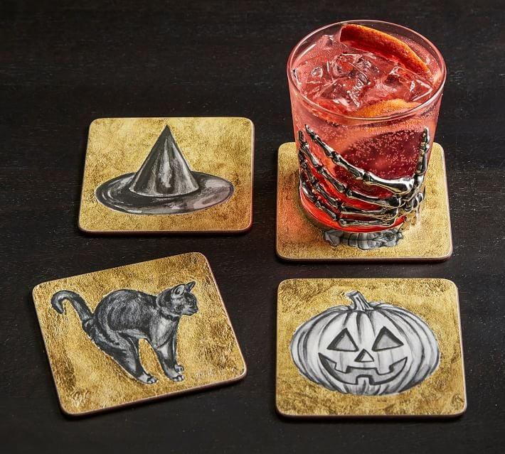 """<p>Set your <a href=""""http://www.popsugar.com/food/halloween-cocktails-47748116"""" class=""""link rapid-noclick-resp"""" rel=""""nofollow noopener"""" target=""""_blank"""" data-ylk=""""slk:spooky drinks"""">spooky drinks</a> (or potions) down on these <span>Halloween Icons Gold Cork Coasters</span> ($15) to protect your dorm tables from wear and tear. </p>"""