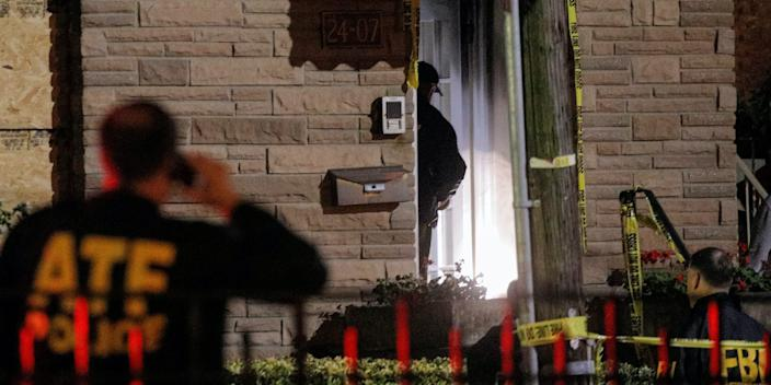 "Law Enforcement officials investigate outside a house, where police say possible bomb-making materials were found, in the Queens borough of New York City, U.S., September 15, 2020. <p class=""copyright"">Brendan McDermid/REUTERS</p>"