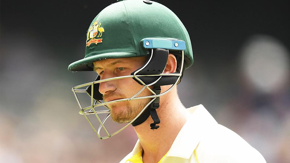 Cameron Bancroft (pictured) walking off after being dismissed.