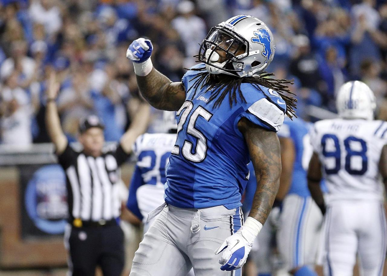 Detroit Lions running back Mikel Leshoure (25) reacts after scoring a touchdown during the second quarter of an NFL football game against the Indianapolis Colts at Ford Field in Detroit, Sunday, Dec. 2, 2012. (AP Photo/Rick Osentoski)
