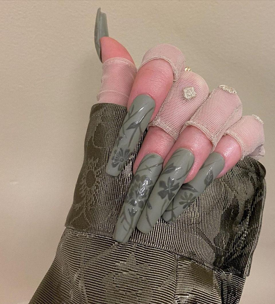 "<p>Of all the statement nails on this list, no one pulls off a coordinated look quite like Billie Eilish. Every time the girl steps on a red carpet, her <del>nails</del> claws <a href=""https://www.seventeen.com/celebrity/music/a30840018/billie-eilish-long-nails-oscars-2020/"" rel=""nofollow noopener"" target=""_blank"" data-ylk=""slk:are focal point"" class=""link rapid-noclick-resp"">are focal point</a> instead of an afterthought. For the 2020 Billboard Music Awards, the singer got herself a custom paint job. She mimicked the sage green florals of her outfit on inches-long coffin nails. Its – and I cannot stress this enough – a <em>look.</em></p>"