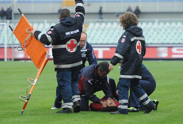 Medics assist Livorno's Piermario Morosini as he lies on the turf after he collapsed during a Serie B soccer match between Pescara and Livorno, at Pescara's Adriatico stadium, central Italy, Saturday, April 14, 2012. Hospital officials say Morosini, who was on loan from Udinese, died after suffering cardiac arrest during his team's Serie B match at Pescara. (AP Photo/Cristiano Chiodi, Lapresse) ITALY OUT