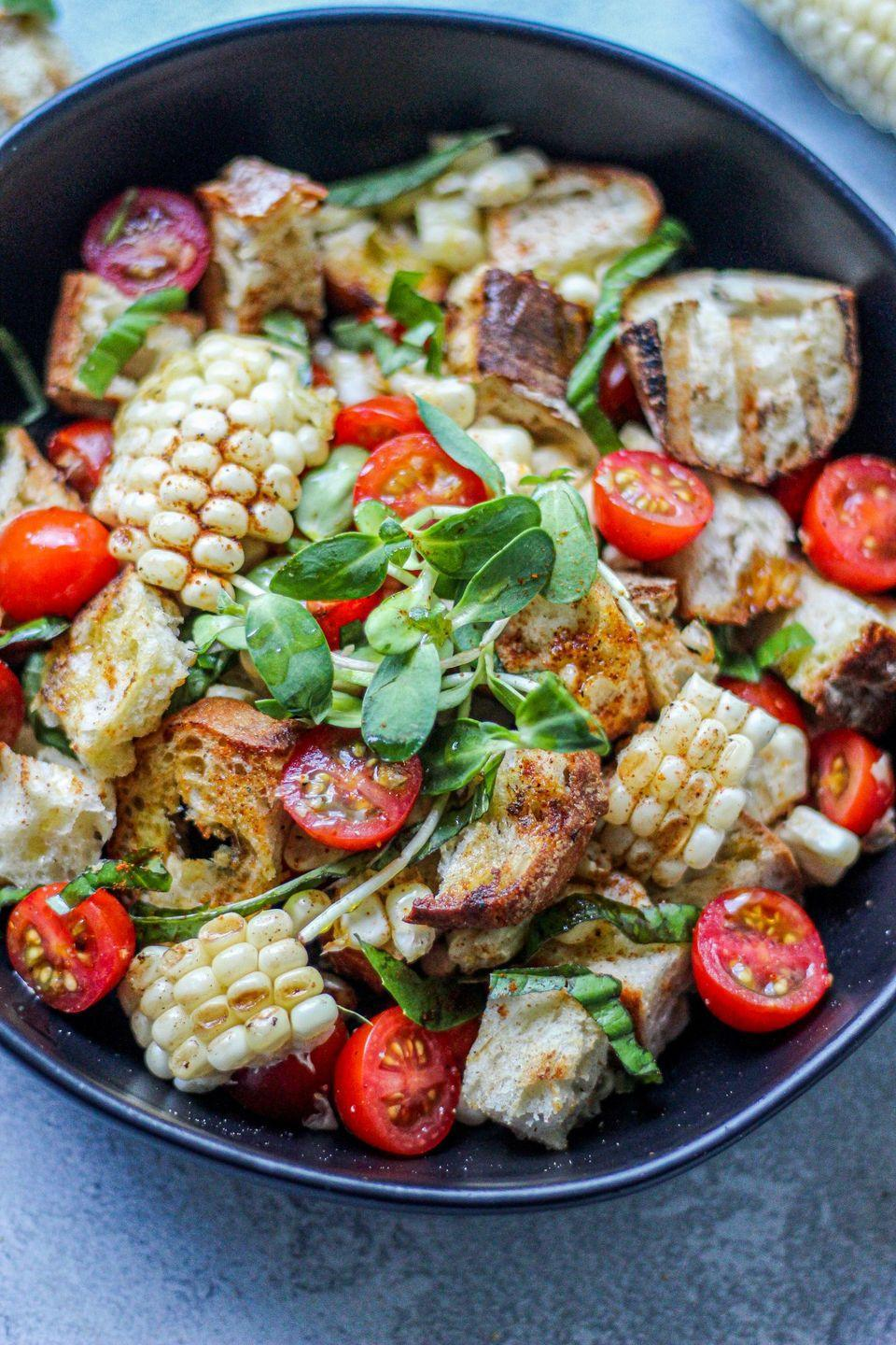 "<p>For a summery brunch, try this Eritrean-inspired panzanella salad with fresh corn and torn pieces of a baguette.</p><p><strong>Get the recipe at <a href=""https://sweetandsorrel.com/corn-fitfit-salad/"" rel=""nofollow noopener"" target=""_blank"" data-ylk=""slk:Sweet and Sorrel"" class=""link rapid-noclick-resp"">Sweet and Sorrel</a>. </strong></p><p><strong><a class=""link rapid-noclick-resp"" href=""https://go.redirectingat.com?id=74968X1596630&url=https%3A%2F%2Fwww.thespicehouse.com%2Fproducts%2Fberbere&sref=https%3A%2F%2Fwww.thepioneerwoman.com%2Ffood-cooking%2Fmeals-menus%2Fg35993911%2Fbest-corn-recipes%2F"" rel=""nofollow noopener"" target=""_blank"" data-ylk=""slk:SHOP BERBERE"">SHOP BERBERE</a><br></strong></p>"