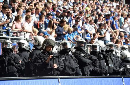 Soccer Football - Bundesliga - Hamburger SV v Borussia Moenchengladbach - Volksparkstadion, Hamburg, Germany - May 12, 2018 Riot police in the stadium during the match REUTERS/Fabian Bimmer