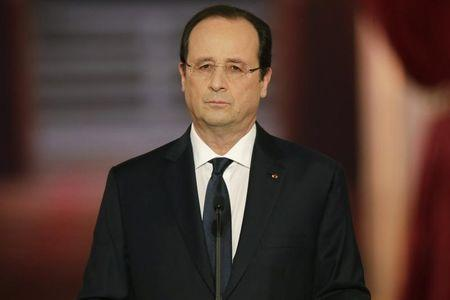 French President Francois Hollande listens to a question during a news conference at the Elysee Palace in Paris