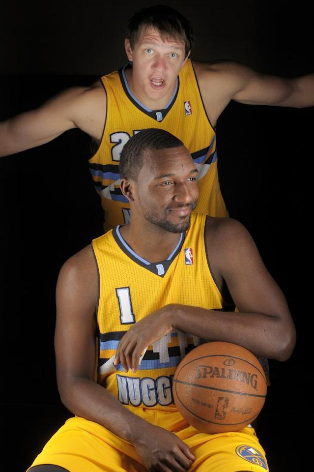 Timofey Mozgov, from Russia, rear, gestures behind teammate Jordan Hamilton during Denver Nuggets NBA basketball media day on Monday, Sept. 30, 2013, in Denver. (AP Photo/Jack Dempsey