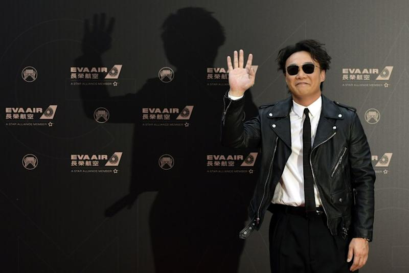 Hong Kong singer Eason Chan gestures upon his arrival for the 30th Golden Melody Awards in Taipei on June 29, 2019. (Photo by Sam YEH / AFP) (Photo credit should read SAM YEH/AFP/Getty Images)