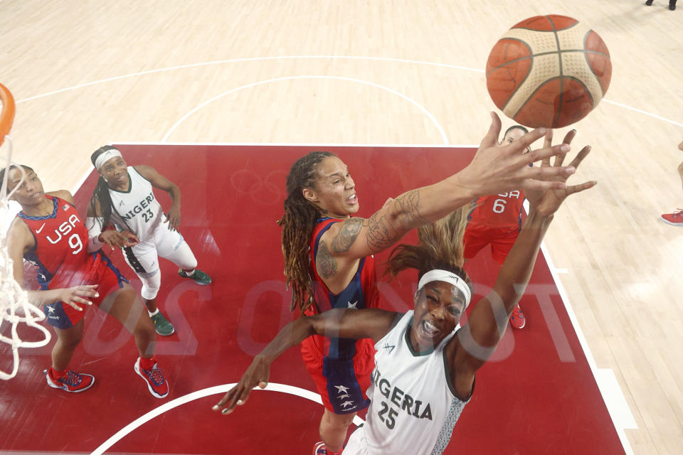 Nigeria's Victoria Macaulay (25) is blocked by United States' Brittney Griner (15) during a women's basketball preliminary round game at the 2020 Summer Olympics, Sunday, July 25, 2021, in Saitama, Japan. (Gregory Shamus/Pool Photo via AP)