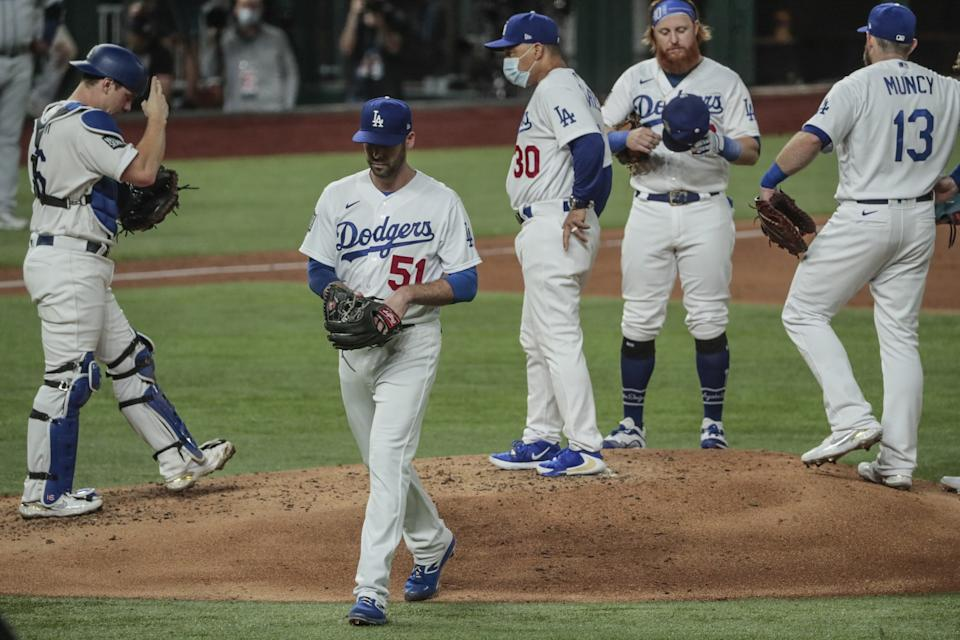 Dodgers relief pitcher Dylan Floro exits the game in the third inning.