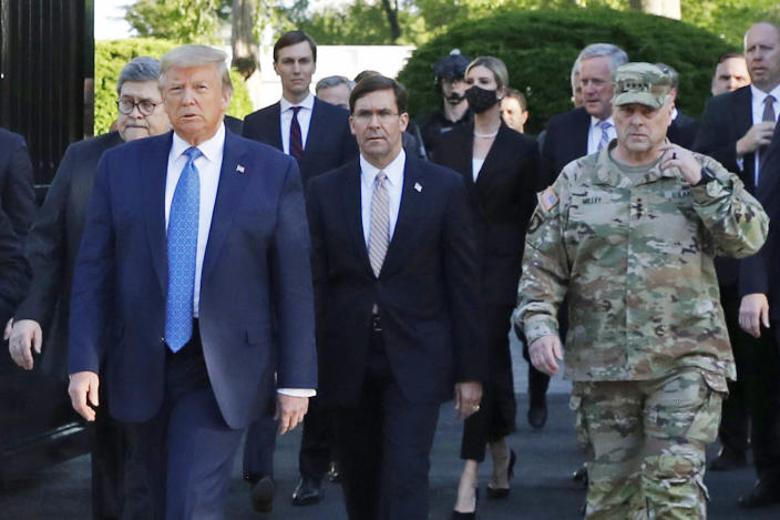 FILE - In this June 1, 2020 file photo, President Donald Trump departs the White House to visit outside St. John's Church, in Washington. Walking behind Trump from left are, Attorney General William Barr, Secretary of Defense Mark Esper and Gen. Mark Milley, chairman of the Joint Chiefs of Staff. Milley put his own job on the line by apologizing for being part of the entourage that accompanied Trump to a photo op outside a church near the White House after peaceful protesters were forcibly removed from the area. (AP Photo/Patrick Semansky, File)