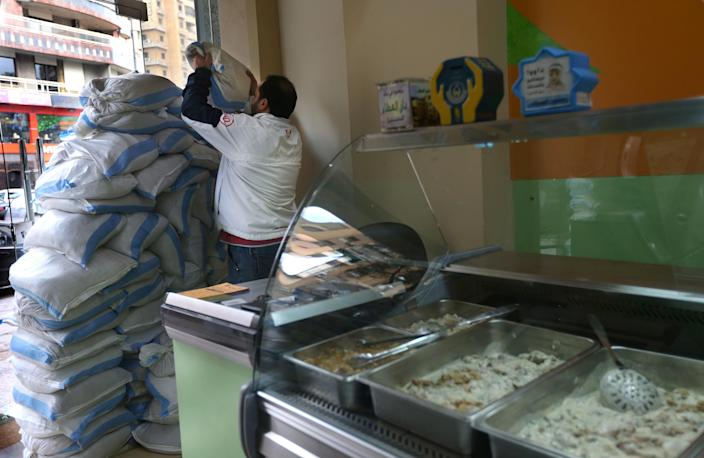 A Lebanese man sets up sand barriers at the window of a chicken shop, in a Shiite neighborhood of a southern suburb of Beirut, Lebanon, Tuesday, Jan. 28, 2014. After a wave of car bomb attacks on Hezbollah's stronghold south of Beirut that left scores of people dead or wounded over the past three months, shop owners scared of more bombs have set up sand barriers in front of their institutions to reduce damage in case more blasts occur. The attacks that hit the south Beirut area known as Dahiyeh (suburb) has sacred many people in the area and increased security measures by Lebanese troops and members of the militant group.(AP Photo/Hussein Malla)