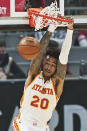 Atlanta Hawks' John Collins dunks the ball in the first half of an NBA basketball game against the Cleveland Cavaliers, Tuesday, Feb. 23, 2021, in Cleveland. (AP Photo/Tony Dejak)