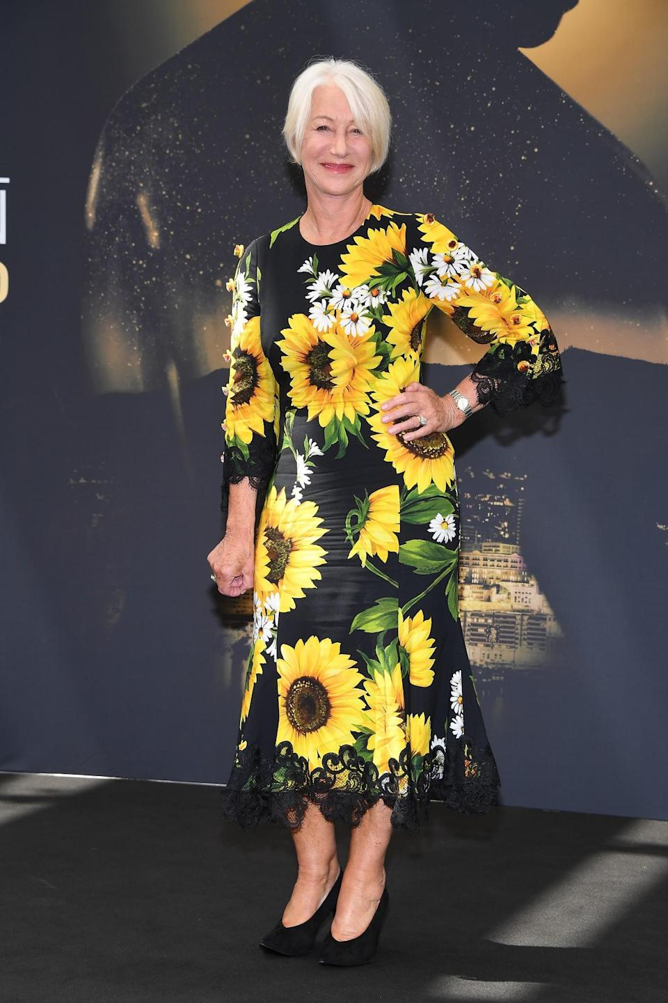 <p>Leave it to Dame Helen to bring a splash of fun and colour to a red carpet event. The British icon paired her sunflower covered Dolce & Gabanna dress with simple black pumps.<br><em>[Photo: Getty]</em> </p>