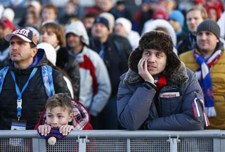 Russian fans watch a screen showing the men's quarter-finals ice hockey game between Russia and Finland at the 2014 Sochi Winter Olympic Games