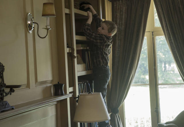 "Joey Matthews (Kyle Catlett) tries to reach for a hidden phone in the ""Mad Love"" episode of ""The Following."""