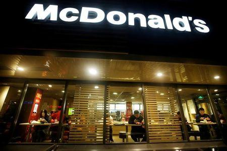FILE PHOTO: Customers eat dinner at a McDonald's store in Beijing