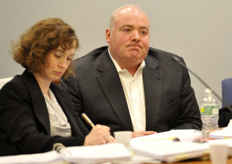 Michael Skakel, right, listens to testimony from his former defense attorney Mickey Sherman at Skakel's habeas corpus hearing at Rockville Superior Court in Vernon, Conn., on Tuesday, April 16, 2013. Skakel's latest appeal trial began Tuesday with his former lawyer defending an accusation that he failed to competently defend Skakel when he was convicted of murder in 2002. (AP Photo/The Stamford Advocate, Jason Rearick, Pool)