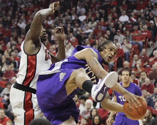 TCU's Adrick McKinney, right, grabs a rebound against UNLV's Quintrell Thomas in the first half of an NCAA college basketball game, Wednesday, Jan. 18, 2012, in Las Vegas. (AP Photo/Julie Jacobson)