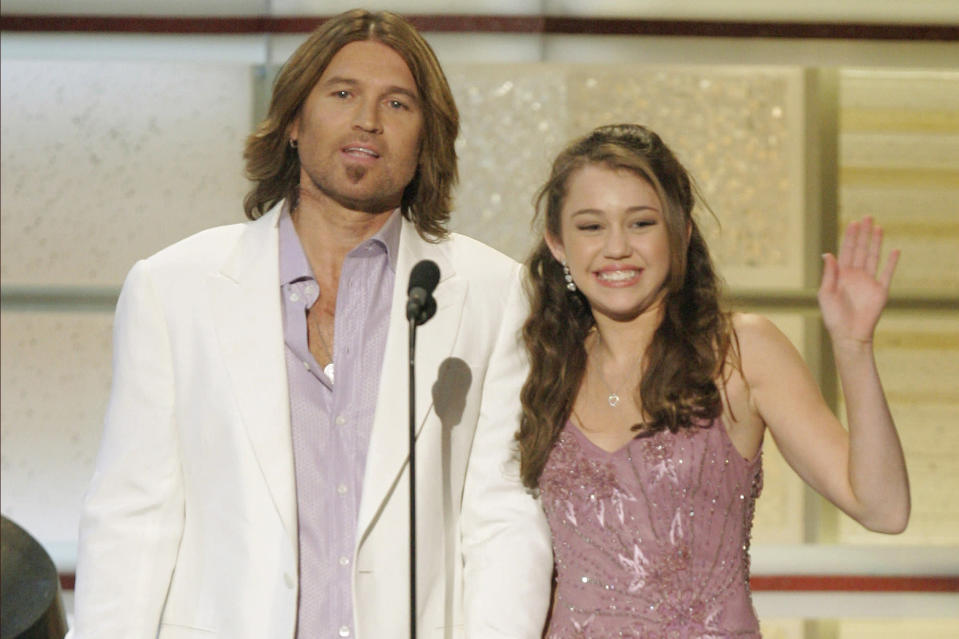 "FILE - In this Tuesday, May 23, 2006 file photo, Billy Ray Cyrus and his daughter, actress Miley Cyrus, present an award during the 41st Academy of Country Music Awards in Las Vegas. On Friday, Oct. 23, 2020, The Associated Press reported on stories circulating online incorrectly asserting at a Miley Cyrus concert in 1993, the pop singer told a 9-year-old girl that anything was possible as long as you believed in God. The little girl said she believed in God and was going to become famous one day by stopping Obamacare and making it illegal to kill babies. That little girl grew up to be Judge Amy Coney Barrett, who has been nominated to a Supreme Court seat. Cyrus was born in 1992 and was only 1 year old in 1993. Barrett, a 48-year-old judge, began her legal career in the late 1990s, when Cyrus was still a child. The Affordable Care Act, also known as ""Obamacare,"" was not enacted until 2010. (AP Photo/Mark J. Terrill)"