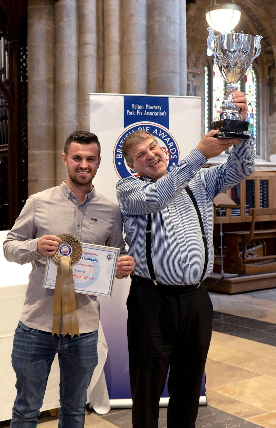 The winner of the Supreme Champion of the 2021 British Pie Awards, Robert Bowring and his son George (Martin Elliott/British Pie Awards/PA) (PA Media)