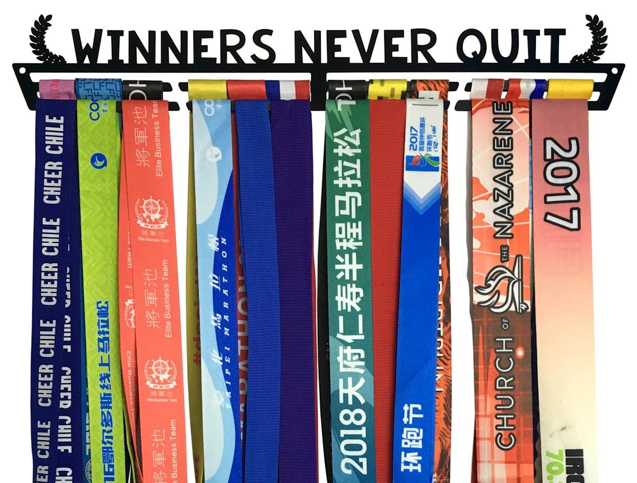 """<p>This <a href=""""https://www.popsugar.com/buy/Crownwyard-Winners-Never-Quit-Medal-Display-Rack-511925?p_name=Crownwyard%20Winners%20Never%20Quit%20Medal%20Display%20Rack&retailer=amazon.com&pid=511925&price=30&evar1=fit%3Aus&evar9=46802629&evar98=https%3A%2F%2Fwww.popsugar.com%2Fphoto-gallery%2F46802629%2Fimage%2F46853705%2FCrownwyard-Winners-Never-Quit-Medal-Display-Rack&prop13=api&pdata=1"""" rel=""""nofollow"""" data-shoppable-link=""""1"""" target=""""_blank"""" class=""""ga-track"""" data-ga-category=""""Related"""" data-ga-label=""""https://www.amazon.com/Crownyard-Medal-Holder-Triathlon-Gymnastics/dp/B0796VH9F8/ref=sr_1_44?crid=2O2F1LQUA8VRQ&amp;dchild=1&amp;keywords=medal+hangers+for+runners&amp;qid=1572973910&amp;sprefix=medal+hanger%2Caps%2C183&amp;sr=8-44"""" data-ga-action=""""In-Line Links"""">Crownwyard Winners Never Quit Medal Display Rack</a> ($30) could work just as well for other sports, but it embodies the spirit of long-distance runners.</p>"""