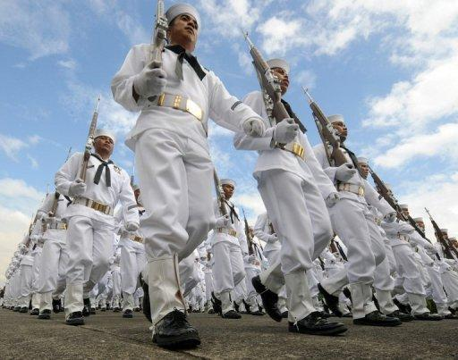 The Philippine Navy march during the 76th anniversary of the Armed Forces of the Philippines at Camp Aguinaldo military headquarters in Quezon city suburban Manila, in 2011. The Philippines said on Wednesday it would hold large-scale military exercises with the United States next month near an area where it is locked in a tense sea territorial row with China