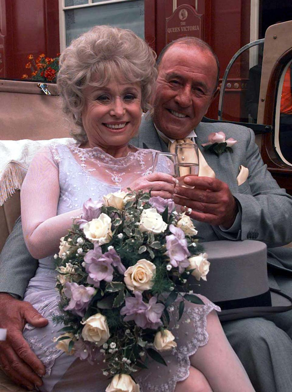 EastEnders stars Barbara Windsor and  Mike Reid, as Peggy Mitchell and Frank Butcher, during a photocall at London's Elstree studios, where  their on-screen wedding reception was filmed.   (Photo by John Stillwell - PA Images/PA Images via Getty Images)