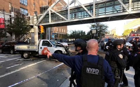 New York City Police Officers respond to report of gunfire along West Street near the pedestrian bridge at Stuyvesant High School in lower Manhattan in New York - Credit: Martin Speechley/NYPD via AP