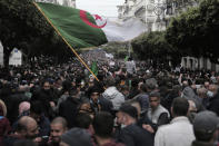 Algerians demonstrate in Algiers to mark the second anniversary of the Hirak movement, Monday Feb. 22, 2021. Thousands of protesters marking the second anniversary of Algeria's pro-democracy movement took to the streets Monday in the Algerian capital where a wall of security forces stepped aside to let marchers pass. (AP Photo/Toufik Doudou)