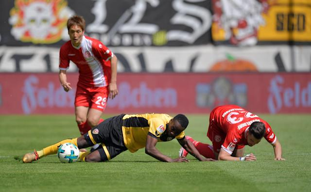 Soccer Football - 2. Bundesliga - Dynamo Dresden v Fortuna Dusseldorf - DDV-Stadion, Dresden, Germany - April 28, 2018 Dynamo Dresden's Erich Berko in action with Fortuna Dusseldorf's Niko Giesselmann REUTERS/Matthias Rietschel DFL RULES TO LIMIT THE ONLINE USAGE DURING MATCH TIME TO 15 PICTURES PER GAME. IMAGE SEQUENCES TO SIMULATE VIDEO IS NOT ALLOWED AT ANY TIME. FOR FURTHER QUERIES PLEASE CONTACT DFL DIRECTLY AT + 49 69 650050