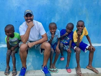 Ricky Patel and children of Gracious Hands Orphanage; Photo Credit: Shaheen Karolia (PRNewsfoto/The Ricky Patel Foundation)