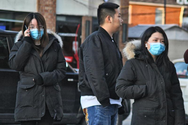 Large crowd of people wearing facemasks line up outside a shop selling industrial strength alcohol disinfectant, hand sanitizer, and n95 facemasks in Toronto, Ontario, Canada on January 29, 2020, as Torontonians scramble to protect themselves amid the outbreak of the novel coronavirus (2019-nCoV). Toronto Public Health confirmed Saturday that a case of the novel coronavirus that originated in Wuhan, China is currently being treated in a Toronto Hospital, as more presumptive cases of the Wuhan coronavirus continue to be reported across the country. Facemasks and disinfectant have been sold out across the country as people have been seen purchasing cases of n95 masks leaving them in very short supply.  (Photo by Creative Touch Imaging Ltd./NurPhoto via Getty Images)
