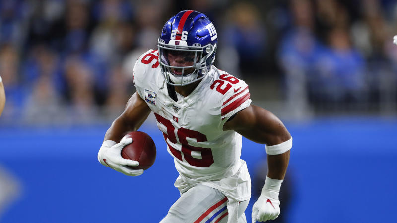 New York Giants running back Saquon Barkley runs the ball against the Detroit Lions during an NFL football game in Detroit, Sunday, Oct. 27, 2019. (AP Photo/Paul Sancya)