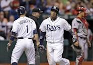 Tampa Bay Rays' Sean Rodriguez, left, and Yunel Escobar, center, celebrate after scoring on a fifth-inning, two-run double by teammate Jose Molina off Los Angeles Angels starting pitcher C.J. Wilson during a baseball game Tuesday, Aug. 27, 2013, in St. Petersburg, Fla. Catching for the Angels is Hank Conger. (AP Photo/Chris O'Meara)