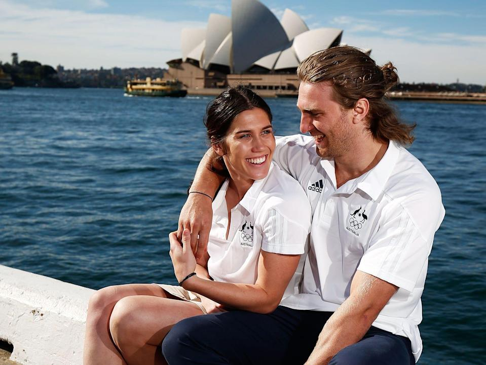 Charlotte Caslick and Lewis Holland pose outside the Sydney Opera House.