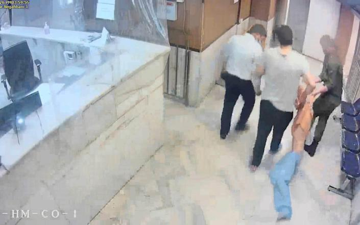 A grab from a leaked video shows guards dragging an emaciated prisoner. - The Justice of Ali