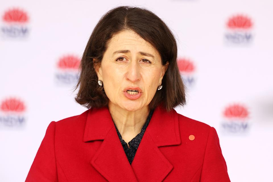 NSW Premier Gladys Berejiklian speaks to the media during a Covid-19 update press conference on July 12. Lockdown restrictions have been tightened across NSW as COVID-19 cases continue to emerge in the community.  Eestrictions are in place across Greater Sydney, the Blue Mountains, the Central Coast and Wollongong with all residents subject to stay-at-home orders are only permitted to leave their homes for essential reasons, including purchasing essential goods, accessing or providing care or healthcare, work, education and exercise. As of 5pm on Friday, exercise is limited to within a 10km radius from home or within the local government area, and with a maximum of two people per group. Browsing in shops is prohibited and only one person per household can leave home for shopping per day. Outdoor public gatherings are limited to two people, while funerals are limited to 10 people only. (Photo by Mark Kolbe/Getty Images)
