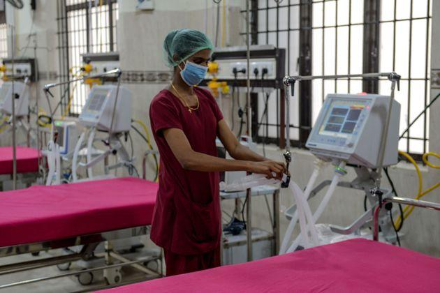 A medical staff checks on a ventilator of an intensive care unit at a newly inaugurated hospital.
