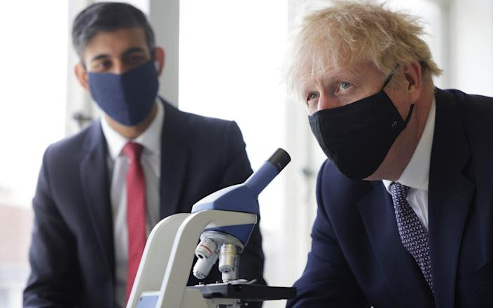 Boris Johnson and Chancellor Rishi Sunak take part in a science lesson at King Solomon Academy in Marylebone