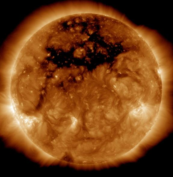 A photo of the sun from NASA's orbiting Solar Dynamics Observatory reveals an enormous coronal hole — a gap in the sun's outer layer and magnetic field the size of 50 Earths. The image was captured Oct