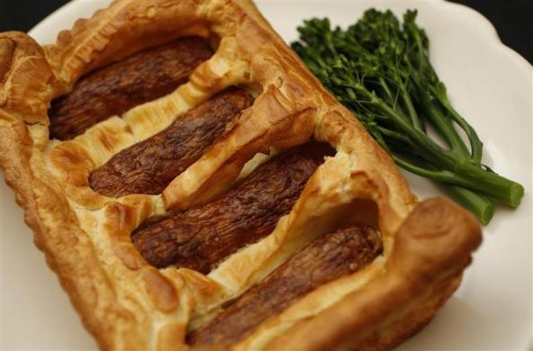 A traditional British dish of sausages baked in batter, called 'Toad in the Hole.'