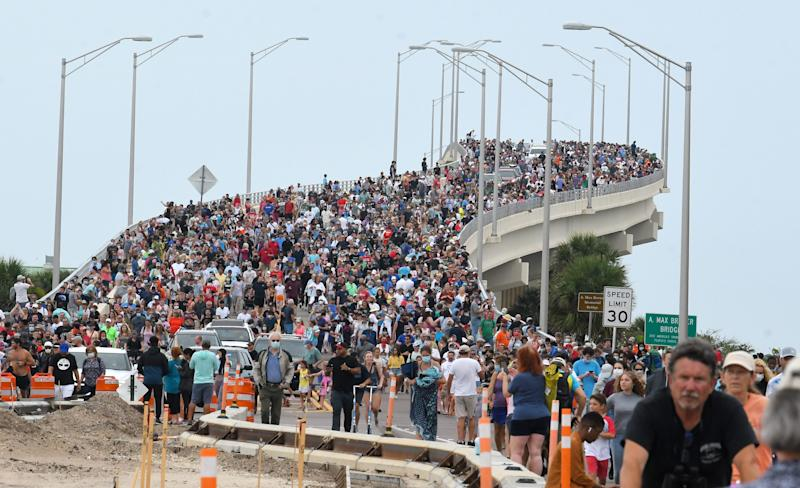 After the launch was scrubbed, spectators from the east side of the bridge blended with those on the west side of A. Max Brewer Bridge in Titusville, to start the walk back to their vehicles. They were hoping to see the first U.S. crewed mission in almost a decade,