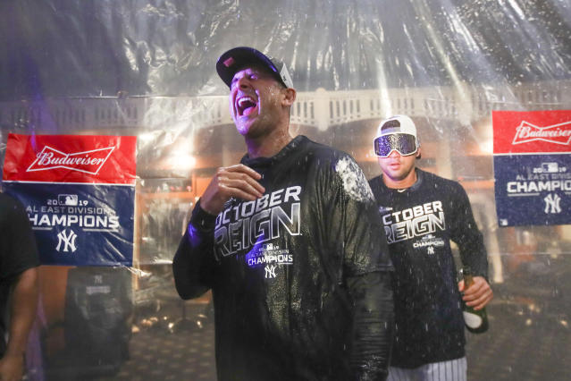 Payers spray New York Yankees manager Aaron Boone as they celebrate after defeating the Los Angeles Angels and clinching the AL East baseball title Thursday, Sept. 19, 2019, in New York. (AP Photo/Mary Altaffer)